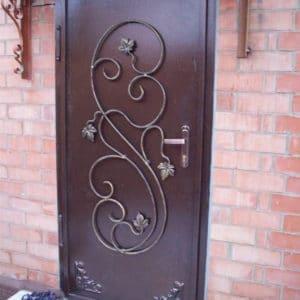 Входная кованая дверь из металла Арт. Д-013